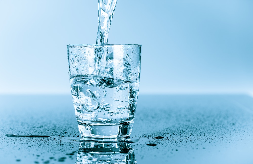 photo of a glass of water being poured which is one of the best home remedy for upset stomach