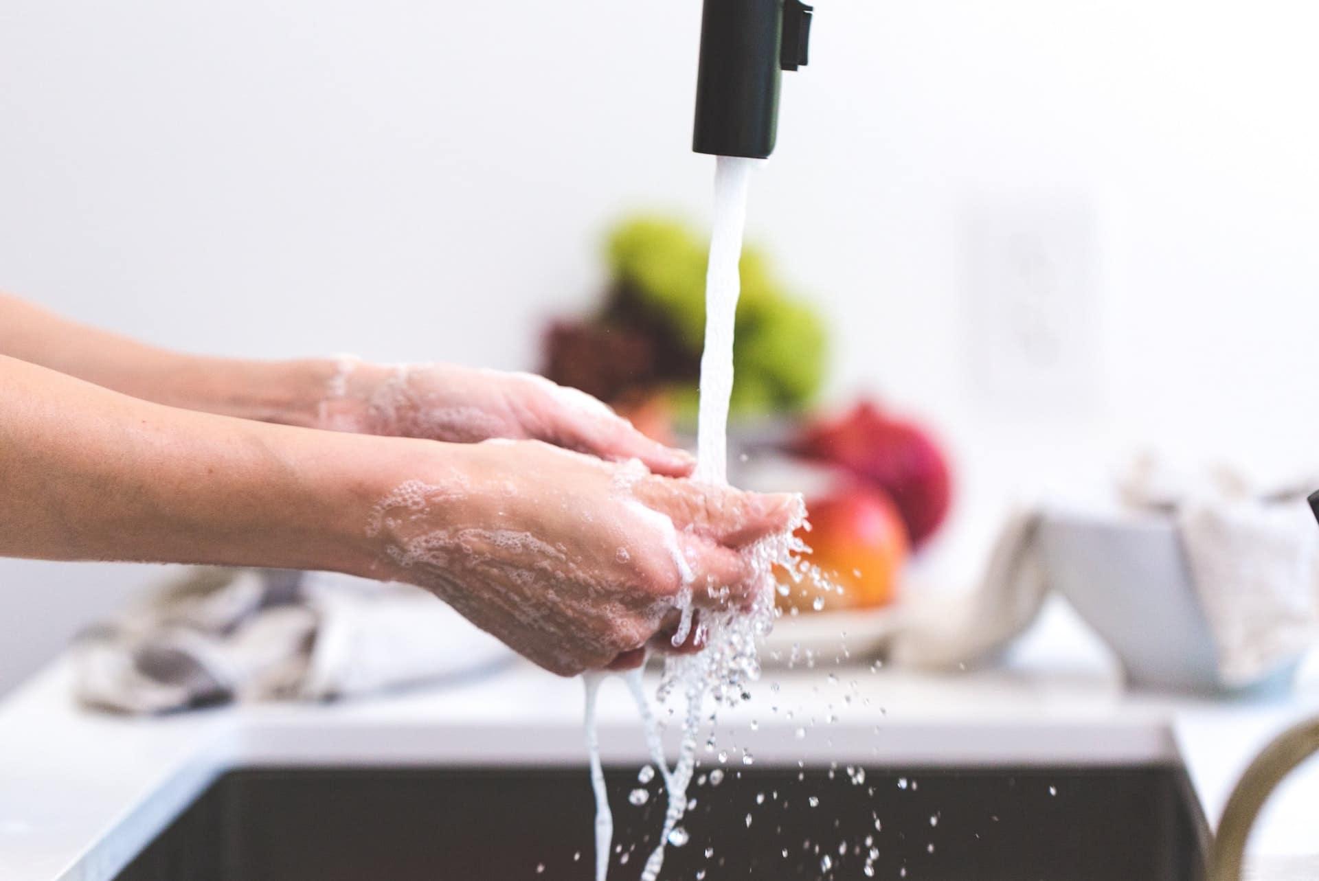 photo of women washing hands thoroughly fulfilling coronavirus safety precautions