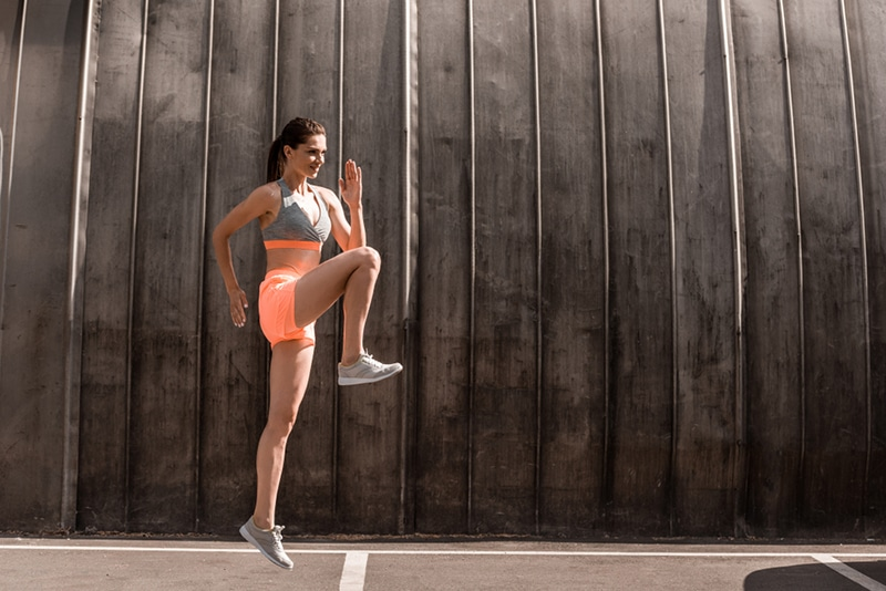 photo of a women performing high knees exercise